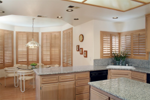beautiful tan shutters in dining room - Southern California Window Coverings