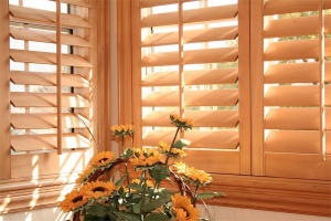 tan wooden blinds with flowers - Southern California Window Coverings